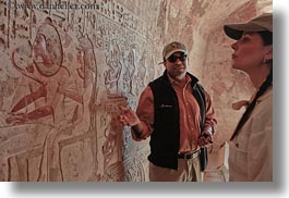 africa, ahmed, al kab, arts, bas reliefs, baseball cap, clothes, egypt, hats, horizontal, hyroglyphics, interpreting, language, people, sculptures, tombs, tour guides, tourists, photograph