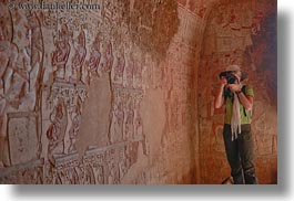 africa, al kab, arts, bas reliefs, cameras, caves, egypt, helenes, horizontal, hyroglyphics, language, people, sculptures, tombs, tourists, photograph