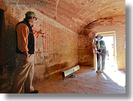 africa, al kab, arts, bas reliefs, baseball cap, caves, clothes, egypt, hats, helenes, horizontal, hyroglyphics, language, people, sculptures, tombs, tour guides, tourists, photograph
