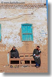 africa, al kab, benches, clothes, egypt, keffiyeh, men, scarves, vertical, villages, windows, womens, photograph