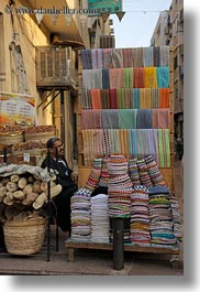 africa, aswan, colorful, egypt, hats, men, vertical, photograph