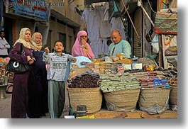 africa, arabic, aswan, buying, clothes, egypt, horizontal, keffiyeh, scarves, spices, style, womens, photograph