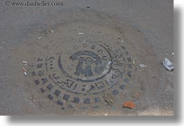 africa, cairo, coptic, covers, egypt, horizontal, manholes, photograph