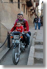 africa, cairo, egypt, families, motorcycles, old town, vertical, photograph