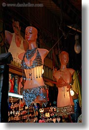 africa, cairo, egypt, illuminated, mannequins, old town, vertical, photograph