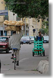 africa, arabic, bicycles, bread, cairo, egypt, heads, men, old town, style, vertical, photograph