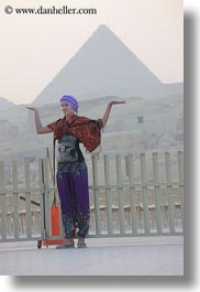 africa, cairo, clothes, egypt, girls, keffiyeh, lamps, people, pyramids, scarves, vertical, photograph