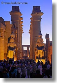 africa, crowds, dusk, egypt, luxor, pillars, temples, vertical, photograph