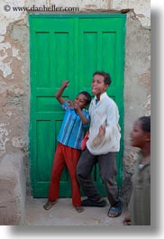 africa, boys, doors, egypt, green, laughing, nubian village, vertical, photograph
