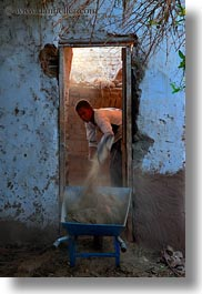 africa, doorways, egypt, men, nubian village, shoveling, vertical, photograph