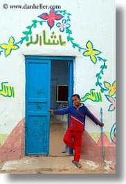 africa, blues, boys, doors, egypt, nubian village, paintings, smiling, vertical, photograph