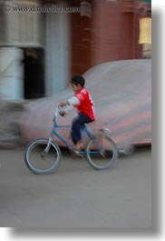africa, bicycles, blur, childrens, egypt, motion, people, vertical, photograph