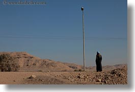 africa, egypt, horizontal, lights, men, people, poles, standing, photograph