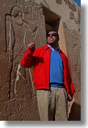 africa, ahmed, bas reliefs, clothes, egypt, gemni, people, sunglasses, talking, tombs, tour guides, vertical, wt people, photograph