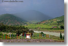 asia, bhutan, buddhist, colors, flags, foggy, green, hills, horizontal, landscapes, religious, stupas, valley, photograph