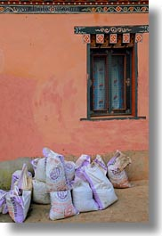 asia, bags, bhutan, cement, lobeysa village, vertical, photograph