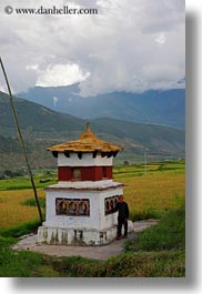 asia, bhutan, buddhist, clouds, lobeysa village, men, nature, prayers, religious, sky, turning, vertical, wheels, photograph