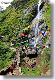 asia, asian, bhutan, buddhist, flags, green, hikers, hiking, lush, nature, people, prayer flags, religious, vertical, water, waterfalls, photograph