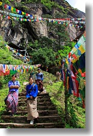 asia, asian, bhutan, buddhist, flags, green, hikers, hiking, lush, people, prayer flags, religious, stairs, structures, vertical, photograph