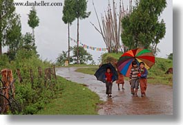 asia, asian, bhutan, childrens, clothes, costumes, emotions, horizontal, people, smiles, style, umbrellas, photograph
