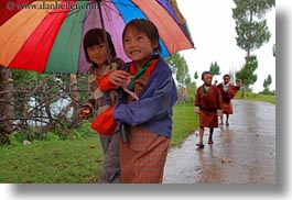asia, asian, bhutan, childrens, clothes, colorful, colors, costumes, emotions, horizontal, people, smiles, style, umbrellas, photograph