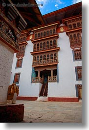asia, asian, bhutan, buddhist, buildings, courtyard, people, punakha dzong, religious, tall, temples, vertical, photograph