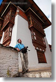 artists, asia, asian, bhutan, cameras, hashmat, people, photographers, punakha dzong, temples, vertical, photograph