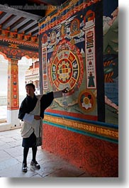 arts, asia, asian, bhutan, buddhist, clothes, interpreting, men, people, punakha dzong, religious, robes, temples, vertical, photograph