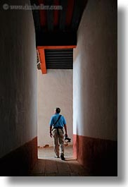 artists, asia, asian, bhutan, cameras, halls, men, people, photographers, punakha dzong, vertical, walking, photograph