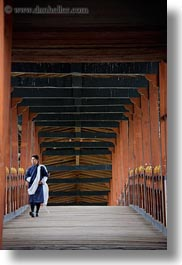asia, asian, bhutan, bridge, buddhist, men, over, people, punakha dzong, religious, temples, vertical, walking, photograph