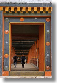 asia, asian, bhutan, bridge, buddhist, clothes, men, over, people, punakha dzong, religious, robes, temples, vertical, walking, photograph