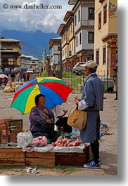 asia, asian, bhutan, farmers, foods, market, people, street market, umbrellas, vertical, photograph