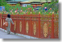 asia, asian, bhutan, buddhist, fences, girls, horizontal, people, religious, roses, style, tashichho dzong, walking, photograph