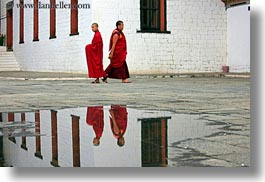 asia, asian, bhutan, buddhist, clothes, horizontal, monks, nature, people, puddle, reflections, religious, robes, style, tashichho dzong, water, photograph
