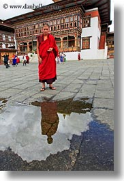 asia, asian, bhutan, buddhist, clothes, monks, nature, people, puddle, reflections, religious, robes, style, tashichho dzong, vertical, water, photograph