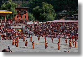 asia, asian, bhutan, buddhist, dancers, horizontal, oranges, people, religious, style, tashichho dzong, photograph