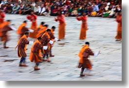 asia, asian, bhutan, buddhist, clothes, costumes, dancers, horizontal, oranges, people, religious, style, tashichho dzong, photograph