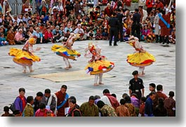 asia, asian, bhutan, buddhist, clothes, costumes, dancers, horizontal, people, religious, spinning, style, tashichho dzong, yellow, photograph