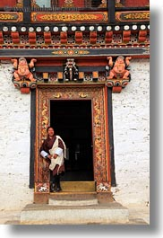asia, asian, bhutan, buddhist, clothes, doors, guides, people, religious, robes, style, tashichho dzong, tours, vertical, photograph