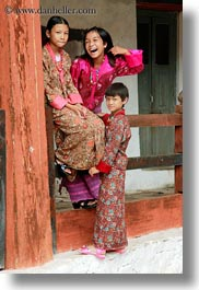 asia, asian, bhutan, girls, laughing, people, vertical, wangduephodrang dzong, photograph