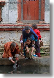 asia, asian, bhutan, childrens, drinking, girls, people, vertical, wangduephodrang dzong, water, photograph