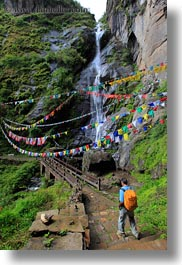 asia, bhutan, bridge, buddhist, flags, hikers, lush, nature, prayer flags, religious, vertical, water, waterfalls, photograph