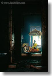 angkor thom, asia, bayon, buddhas, cambodia, candles, lighting, vertical, womens, photograph