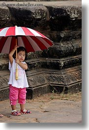 angkor wat, asia, cambodia, childrens, girls, people, red, striped, umbrellas, vertical, white, photograph