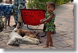 angkor wat, asia, cambodia, childrens, dogs, horizontal, nursing, people, puppies, toddlers, photograph