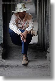 angkor wat, asia, cambodia, hats, men, people, sitting, vertical, photograph