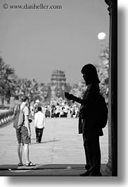 angkor wat, asia, black and white, cambodia, doors, frames, people, silhouettes, vertical, photograph