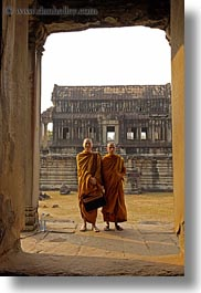 angkor wat, asia, browns, cambodia, monks, people, robes, two, vertical, photograph