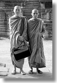 angkor wat, asia, black and white, browns, cambodia, monks, people, robes, two, vertical, photograph