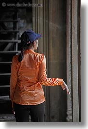 angkor wat, asia, baseball, blues, cambodia, cap, oranges, people, vertical, womens, photograph